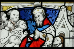 Corporal Acts of Mercy painted stained glass panel
